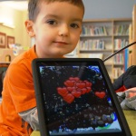 Young boy with iPad