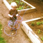 Child with tomato cage at Glenside Garden
