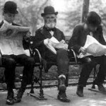 Men on park bench reading newspapers