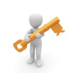 a figure holding a key