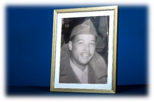 This is photo of a man in military uniform and hat.